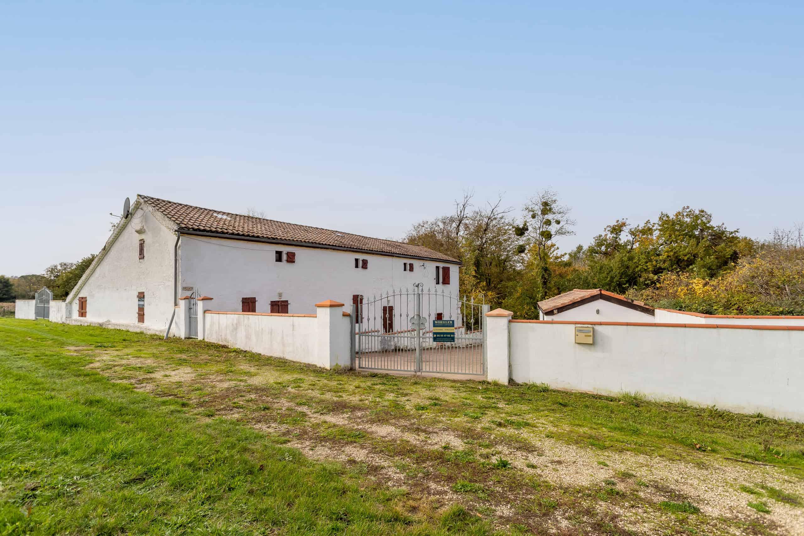 Stone farmhouse near vineyards
