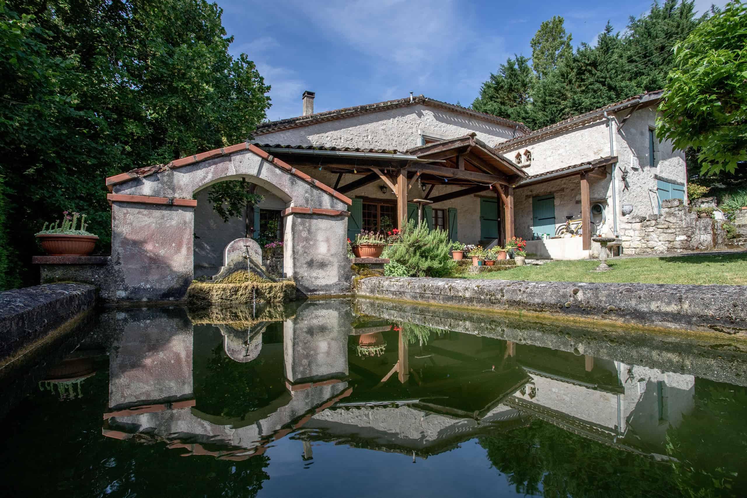 Stone farmhouse near a pretty village